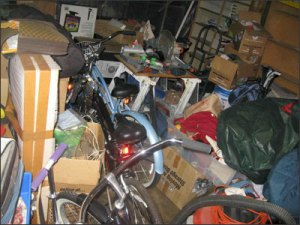 photo of garage filled with household clutter and no room for cars