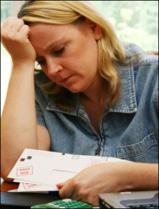photo of woman agonizing over past due bills