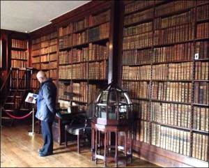 photo of one wall of books in Dunham Massey's library
