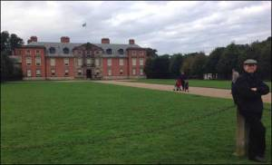 photo of author's husband in front of Dunham Massey