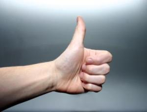 photo of hand with thumb up in an encouraging thumbs-up position