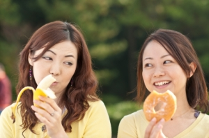 photo of two young women comparing food choices