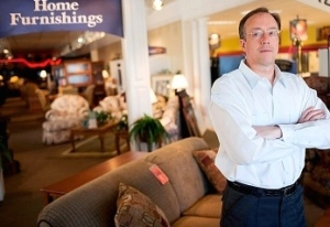 photo of resistant customer in furniture store