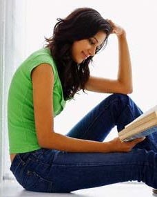 photo of young woman reading a book