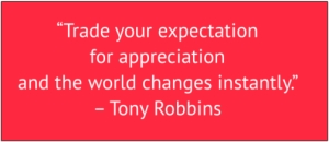 "red box with white text: ""Trade your expectation for appreciation and the world changes instantly."" – Tony Robbins"