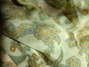 photo of green and gold paisley-print, 100% silk scarf