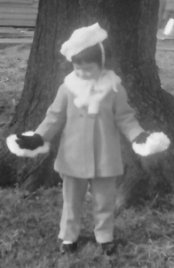 photo of author at age three in a glamorous white fox hat, stole, and muffs
