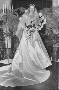photo of 1950s bride in traditional white dress with train