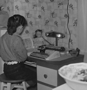 1950s photo of little girl at child's desk