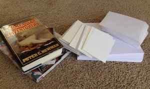 photo of piles of books, notecards, envelopes, paper