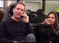 photo of guy on cell phone with woman beside him forced to listen – and not very happy about it
