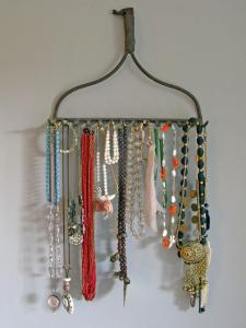photo of metal rake head holding necklaces