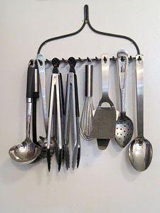 photo of metal head of old rake holding kitchen utensils