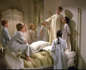 photo of Julie Andrews with the Von Trapp kiddos, belting out