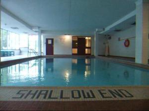 "photo of indoor pool with ""shallow end"" clearly marked"