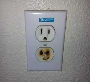 photo of blackened electrical outlet