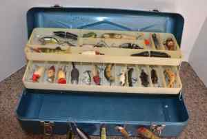 photo of fishing tackle box filled with lures
