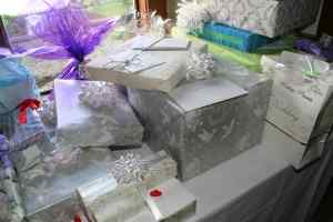 photo of table full of beautifully wrapped wedding gifts