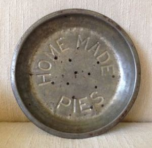 "photo of antique pie tin with ""Home Made Pies"" embossed on it"