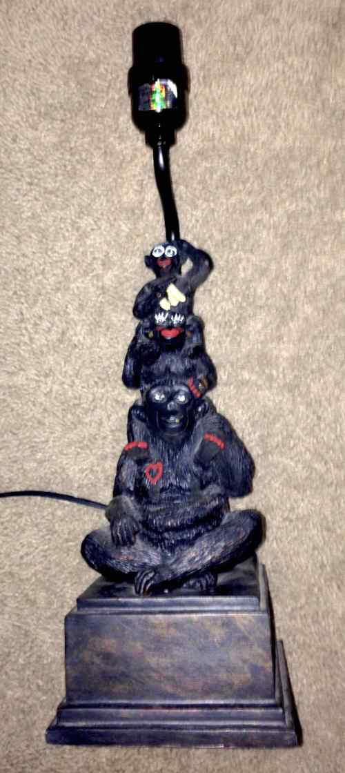 lamp base of three black monkeys stacked on top of each other